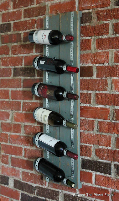 Use pallet boards and plumbers tape to make an industrial wine rack