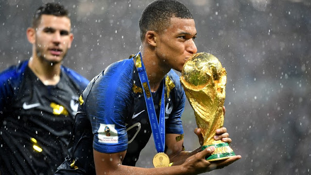 France forward Kylian Mbappe, a goalscorer in the showpiece, takes the FIFA Young Player award. And he Sealed Trophy with a kiss.