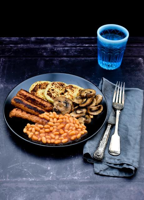 A full vegetarian breakfast on a black plate