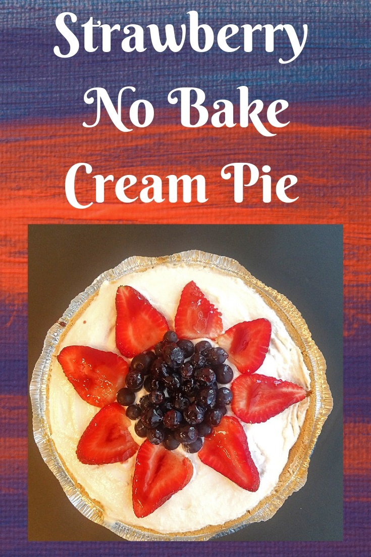 this is a no bake cheese pie that is decorated for the 4th of July picnic. It has a star made out of strawberries and blueberries on top with jam to make it shine