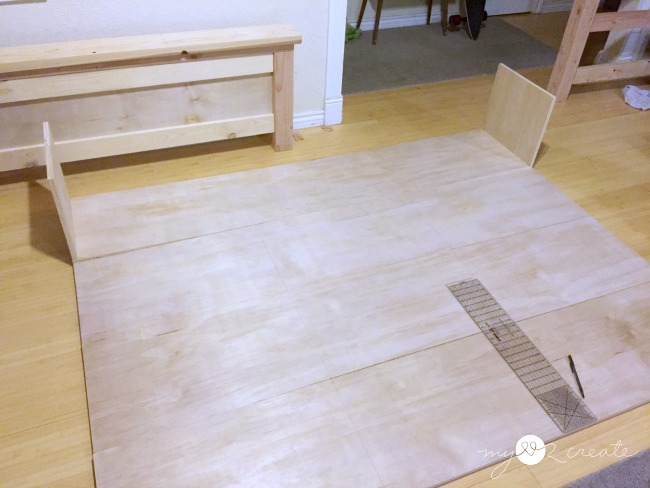 measuring where to place plywood dividers for storage boxes