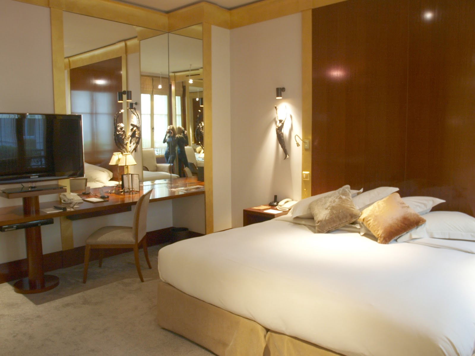 Warm gold and brown in guest room at Park Hyatt Paris by Hello Lovely Studio