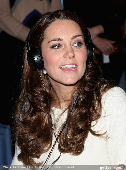 Catherine, Duchess of Cambridge watches live filming of a scene during an official visit to the set of Downton Abbey