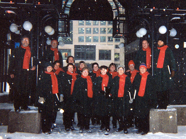 Cozy in our cloaks, carolling on Sparks Street, Ottawa