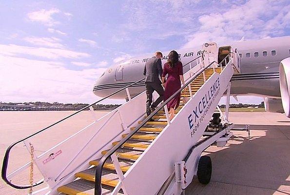 Meghan Markle wore Hugo Boss Eodora dark pink midi dress, and Aquazzura Casablanca style pumps she carried the Cuyana handbag