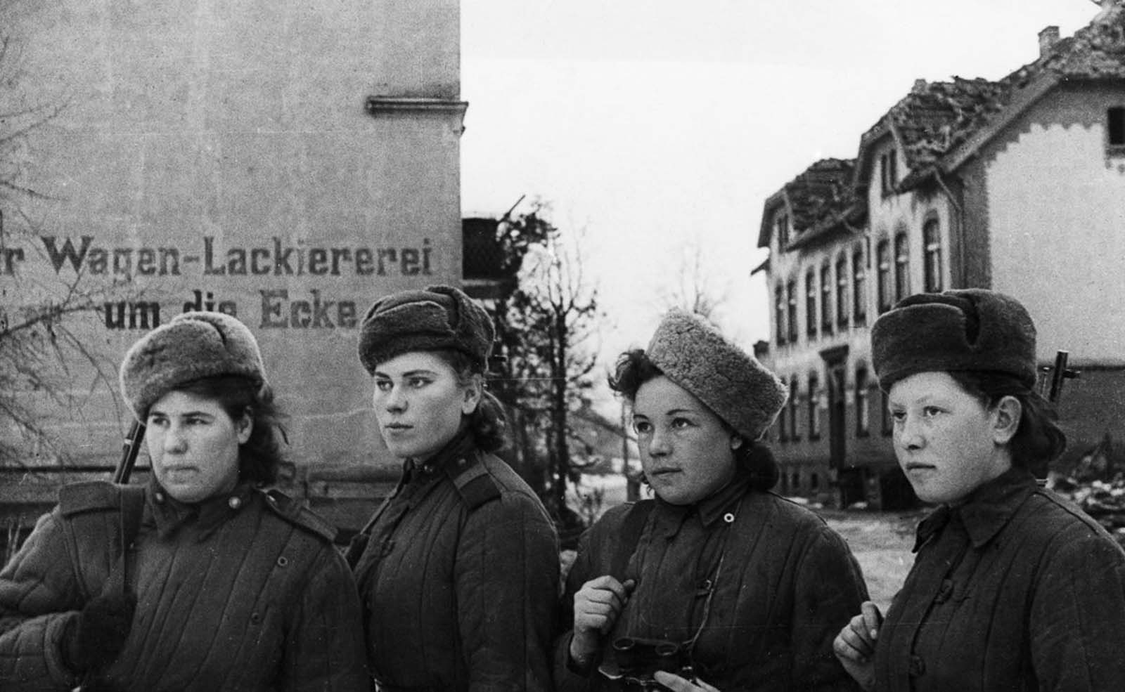 Snipers inspect an East Prussian town recently captured by the Soviets. February, 1945.