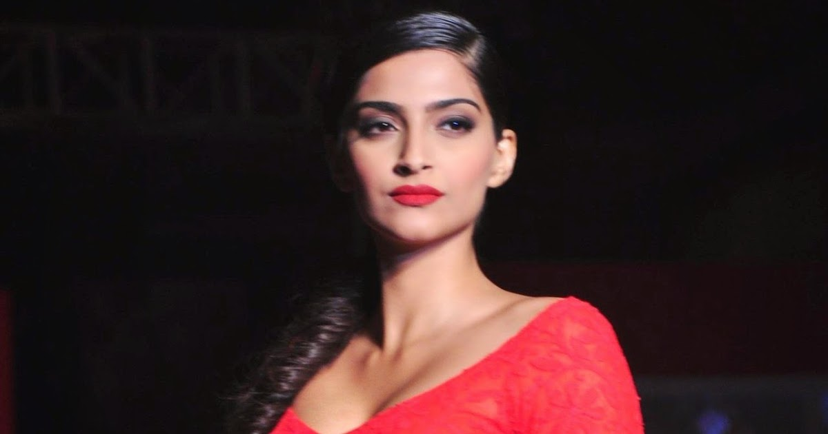 Sexy Sonam Kapoor Hot Navel Show Photos In Red Dress