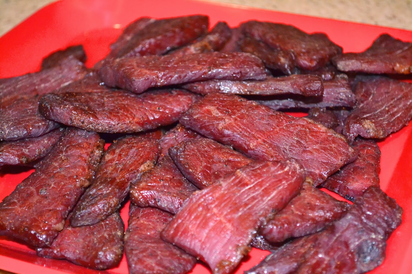 This truly is the BEST beef jerky recipe! It's easy to make, marinated with delicious savory flavors (no added sugar!), and it's totally irresistible!Total Time: 8 hrs 10 mins.