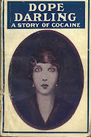 An image of the front cover of David Garnett's first published book Dope Darling (written as Leda Burke). The image is of a young woman staring blankly out at the reader.