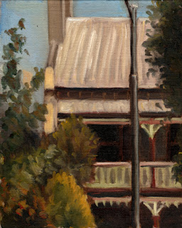 Oil painting of a double-storey Victorian-era terrace house with trees and shrubs and a street light in the foreground.