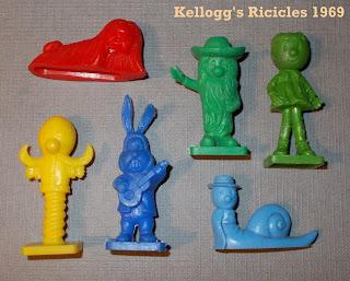 16 Bonecos Diferentes; 1968; Barrel Organ; Brain the Snail; Carrocel Mágico Olá; Dougal Dog; Dylan the Rabbit; Ermintrude; Florence; Gelados Olá; Grátis Carrocel Mágico Olá; Kellogg's Premiums; Kellogg's Ricicles; Magic Roundabout Biscuits; Motor Trike; Motor-tricycle; Mr MacHenry; Mr Rusty; Nabisco Foods; Nabisco Premiums; Olá Ice Cream; Ola Premiums; Paul; Penelope; Peter; Ricicles Premiums; Rosalie; Serge Danot; Small Scale World; smallscaleworld.blogspot.com; Tatra Plastics; The Magic Roundabout; Tito Premiums; Tweet and Tweet-tweet; Zebedee;