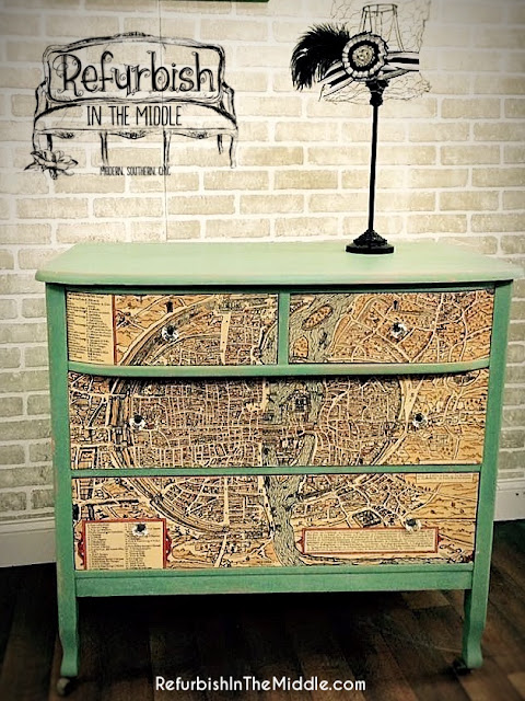 three drawer vintage dresser in Dixie Belle's Mint Julep chalk paint, accented with map print on drawers
