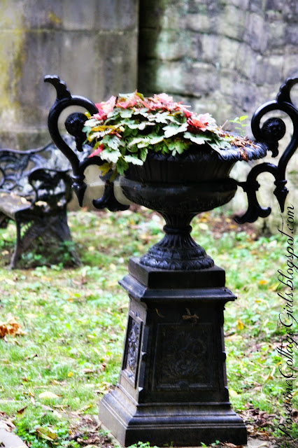 Beautiful Black metal urn and bench outside the Mausoleum of the Belle Meade Plantation | rosevinecottagegirls.com | (C) Rosevine Cottage Girls