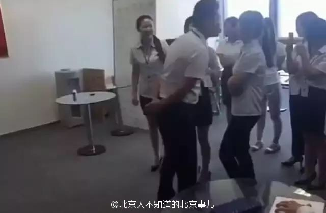 Company In China Forces Their Female Employees To Kiss Their Male Boss On The Lips Each Morning!