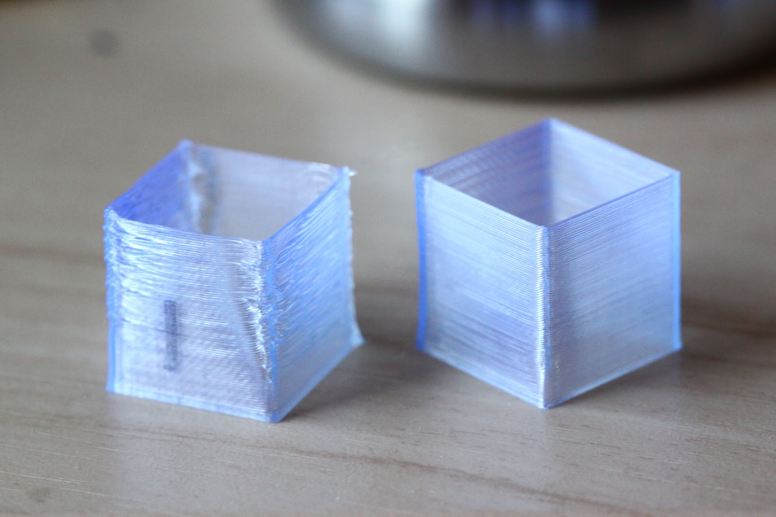 print with curled corners next to one without