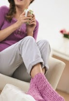 http://www.letsknit.co.uk/free-knitting-patterns/lacy-cabled-socks