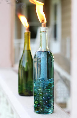 http://helloglow.co/diy-wine-bottle-citronella-candles/