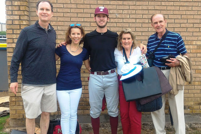 College student with his parents and grandparents