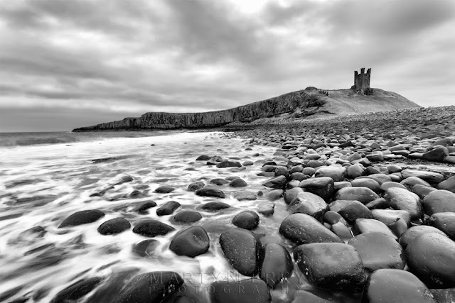Dunstanburgh Castle in black and white by Martyn Ferry Photography
