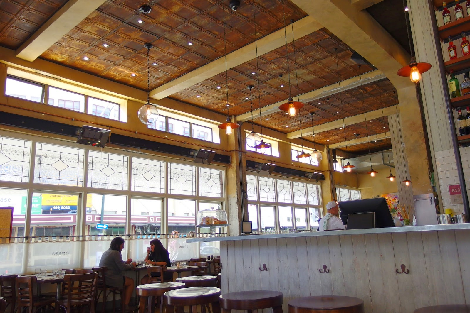 Beautiful natural light, high ceiling and wooden framed windows