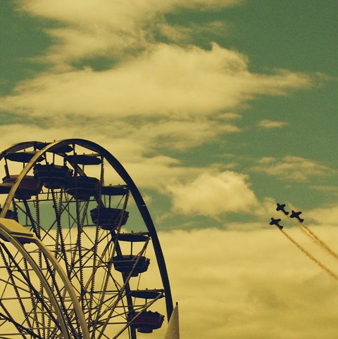 Ferris wheel and air show