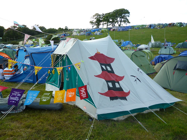 tent in a festival field with bunting