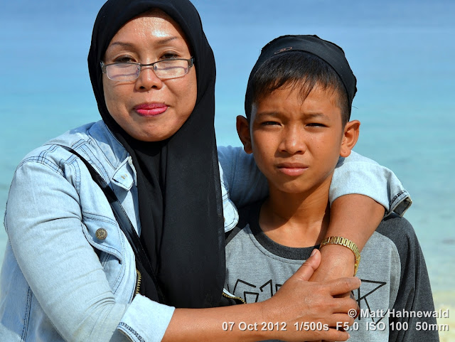 street portrait, double portrait, Indonesia, Central Sulawesi, beach, charming, outgoing, smiling, posing, Indonesian Muslim lady with son