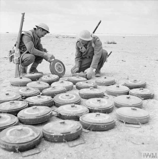 British sappers disarm German mines in North Africa on 12 January 1942 worldwartwo.filminspector.com