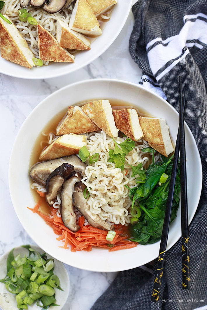 Vegan ramen recipe with spinach, mushrooms, carrots, and tofu.