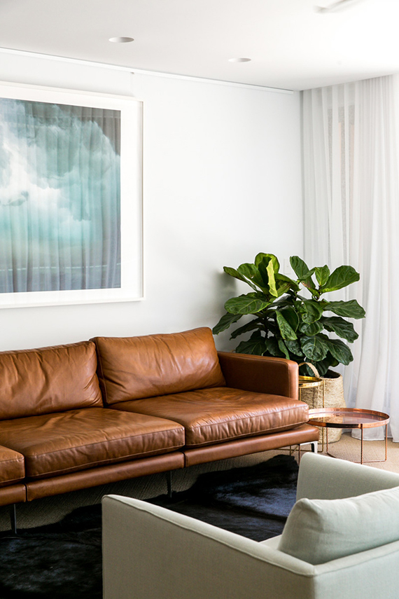 Tan leather sofas | Image via C+M Studio