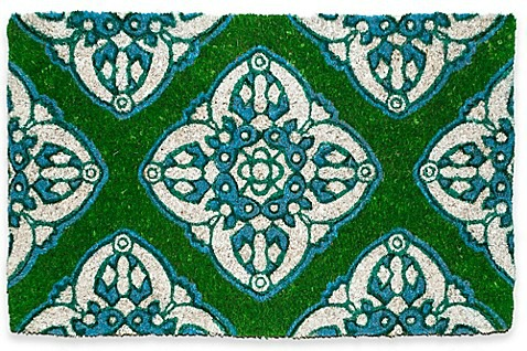 green and blue welcome mat