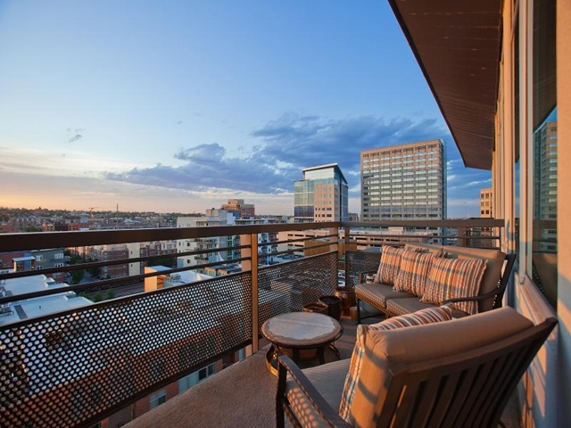 Terrace with two chairs in Denver penthouse apartment