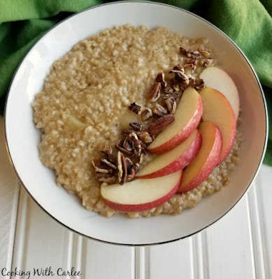 bowl of apple steel cut oatmeal with apple slices and pecans