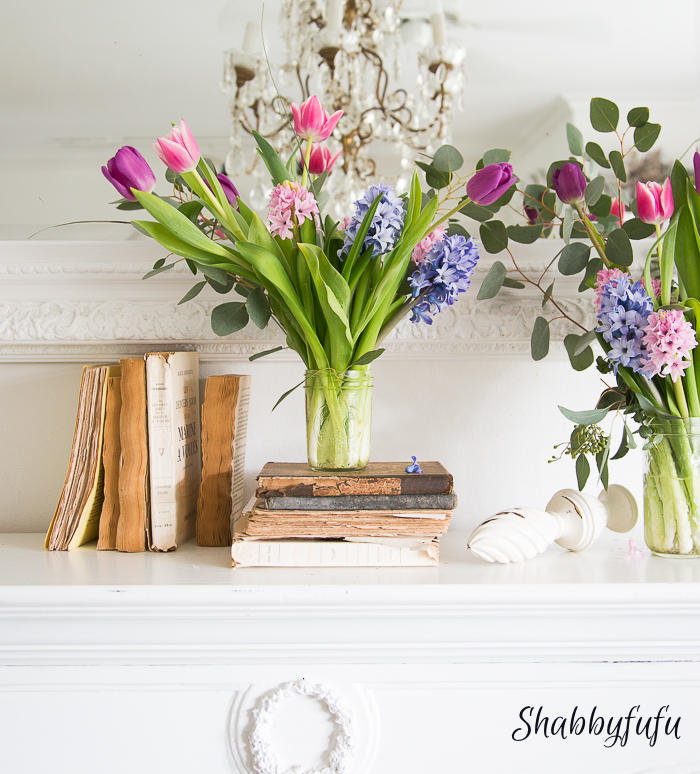books and flowers on a french mantel