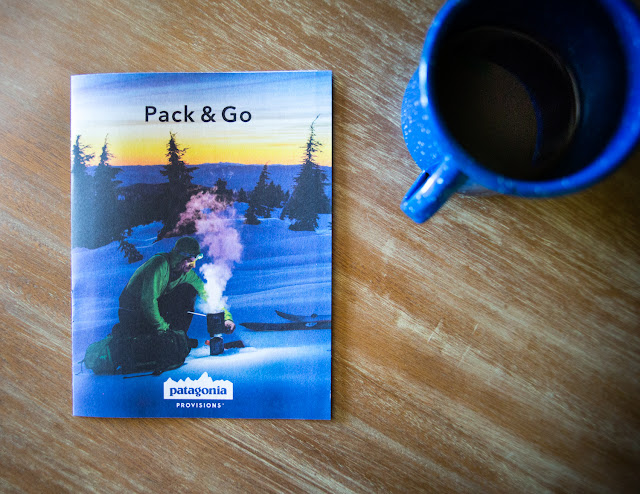 Professional snowboarder Josh Dirksen cooks on the cover of the Patagonia Provisions catalog.