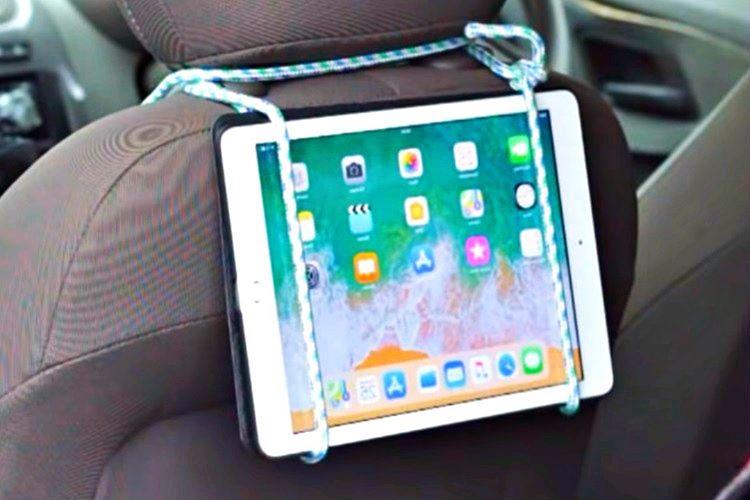 Tablet sabitleyiciniz bulunmuyorsa bagaj sabitleme ipini kullanarak koltuğun kafalığına bağlayabilirsiniz.