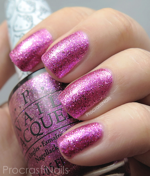 Swatch of the bold magenta microglitter nail polish OPI Starry-Eyed for Dear Daniel