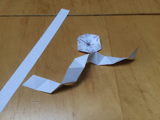 strip of paper folded ready for making a hexahexaflexagon