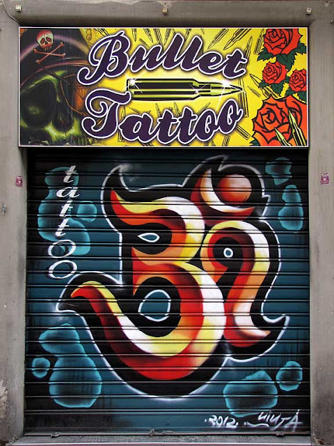 Decorated shutter, Bullet Tattoo in via Mentana, Livorno