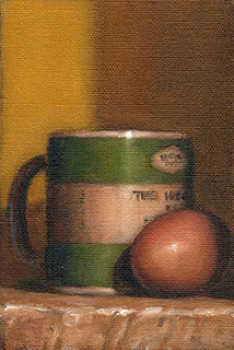 Still life oil painting of a green and white porcelain mug beside an egg.