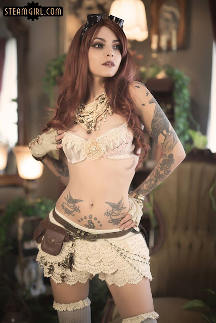 Steampunk Burlesque dancer in lace underwear (shorts/knickers/bloomers) with lace bra, jewelry, gloves and goggles. Sexy steampunk burlesque clothing.