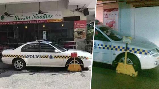 Gambar Kereta Peronda Polis Kena Clamp Ini Buat Netizen Terhibur