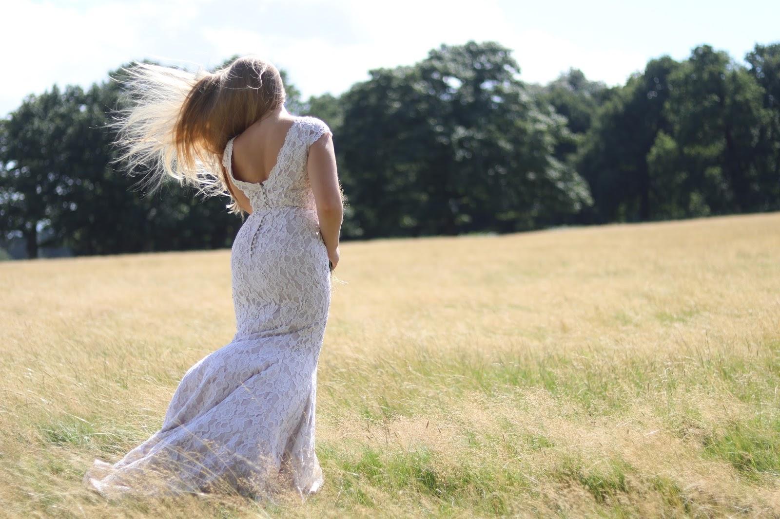 Katie Heath wearing a Jacques Vert Wedding Dress in Richmond Park Meadow