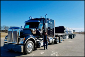 Keim TS driver Ralph Cowan with his Kenworth W990