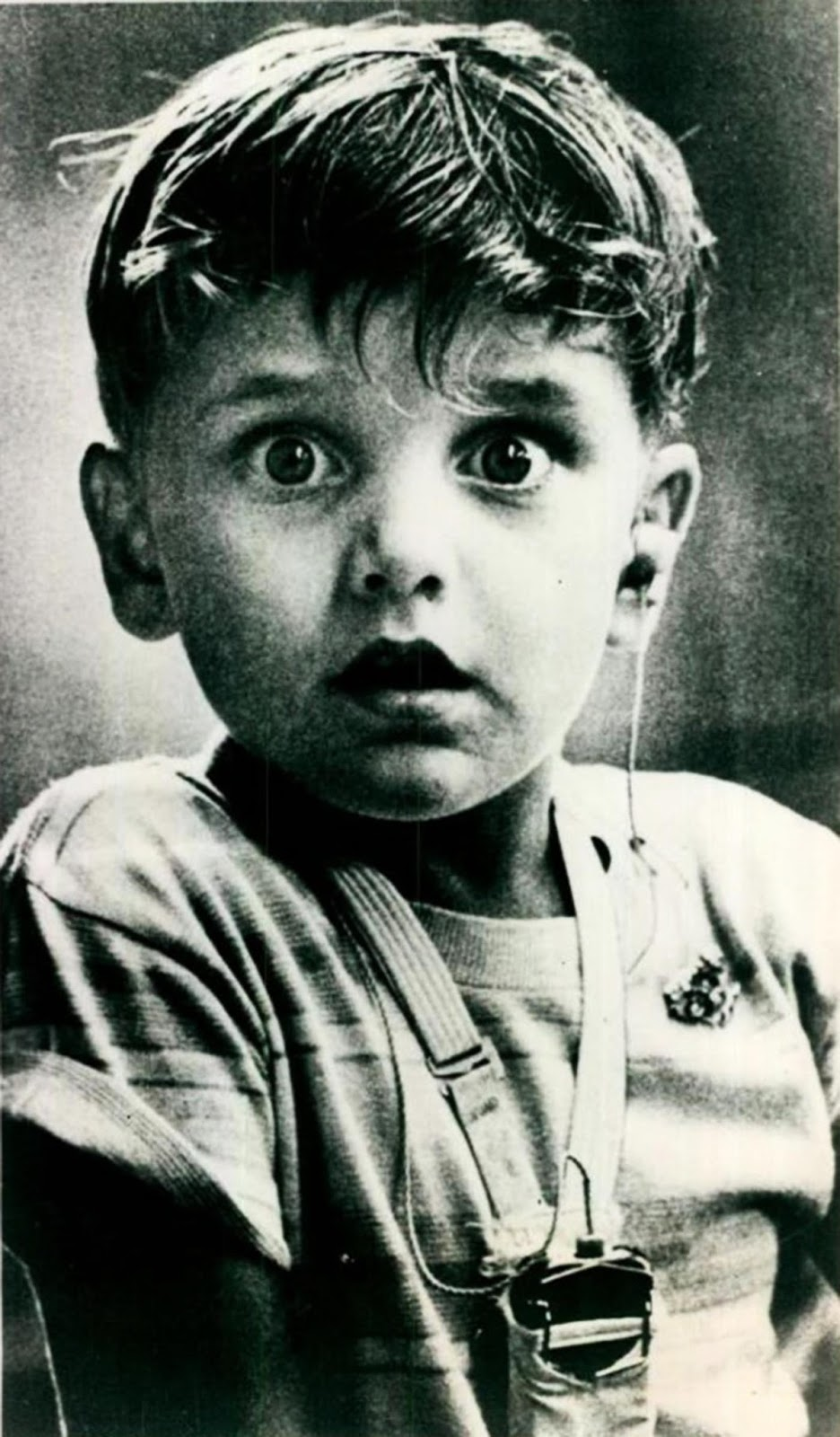 The exact moment when Harold Whittles, born deaf, hears for the first time after placement of earpiece.
