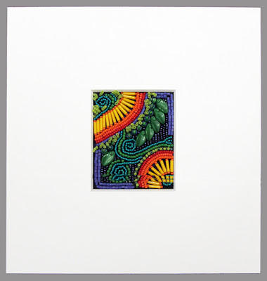 how to frame bead embroidery, mat placed over beadwork