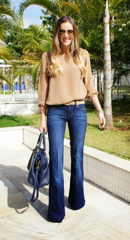 Wearing a Flared Jeans-70s with Nude Beige Shirt and Blue Bag for Stylish Spring Look