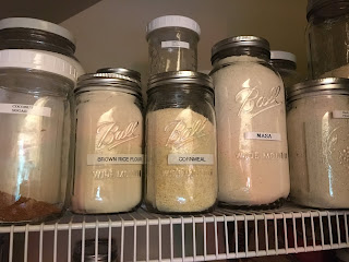 Jars of milled grains from zero waste vegan pantry https://trimazing.com