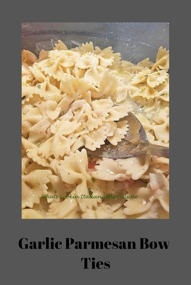 bow ties with cheese sauce on top butter, garlic and easy to make