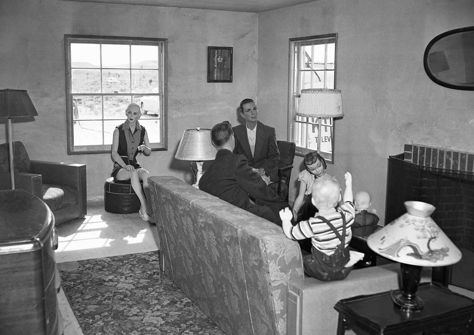 (1 of 2) Mannequins representing a typical American family gathered in a living room are pictured on March 15, 1953 in House No. 2, awaiting an atomic test explosion on the Nevada Proving Grounds.